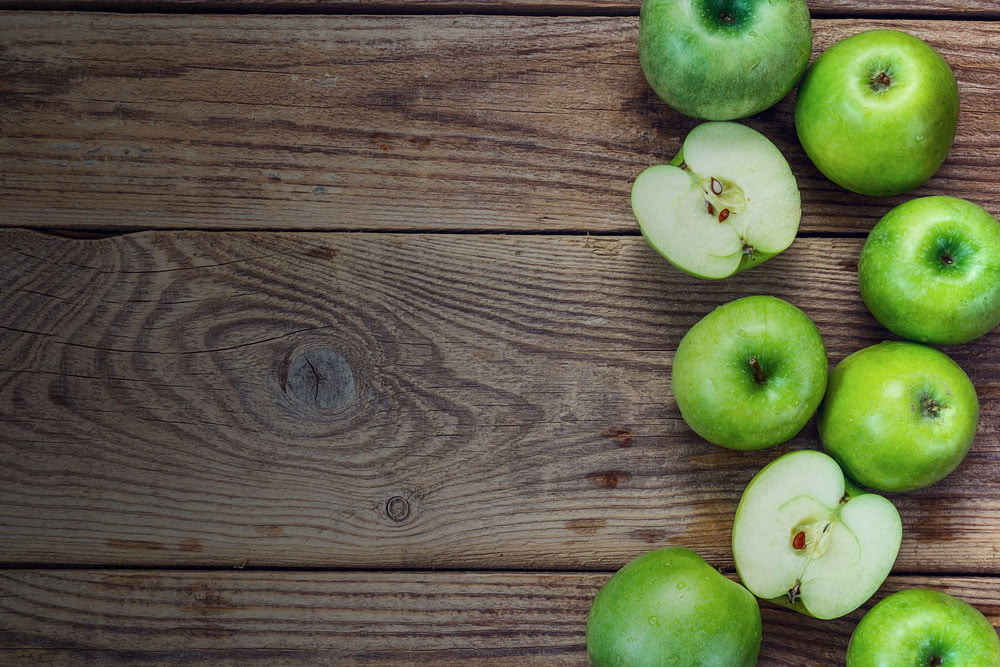 green apples on wood slider